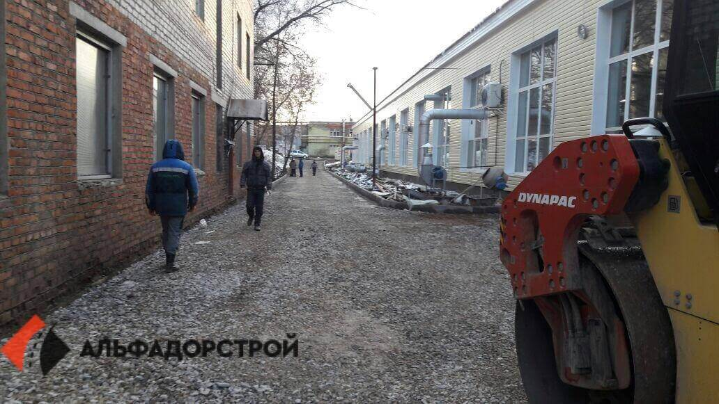 асфальтирование территории склада фото 8